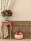 Pink table with flowers. Composition in the style of Provence, consisting of antique pink console and flowers against of curtains and beige walls Stock Images