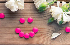 Pink tablet and flowers Royalty Free Stock Image