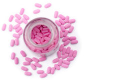 PINK TABLET MEDICINE. Pink tablet capsule pill medicine with clear bottle on white background Stock Photos