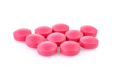 Pink tablet on white background Stock Photos