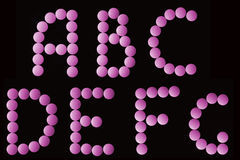 Pink tablets alphabet Royalty Free Stock Photography