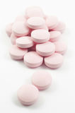 Pink tablets and pills Royalty Free Stock Photo