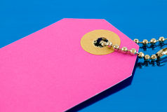 Pink tag on chain Stock Photos