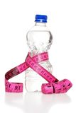 Pink Tape Measure And Water Bottle Royalty Free Stock Photography