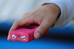Pink Taser. Close up view of someone holding a pink taser stock photos