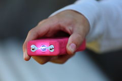 Pink Taser. Close up view of someone holding a pink taser Royalty Free Stock Photography