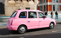 Pink taxi royalty free stock photo