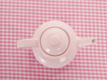 Pink tea pot on table cloth from the top Stock Images