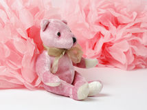 Pink teddy bear and paper decor, pom-pom. Decorative star, pearl beads and pink and white pom pom Royalty Free Stock Photos
