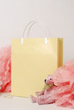 Pink teddy bear and paper decor, pom-pom with paper package for shopping. Beige gift bag with a paper decor, pom-pom and teddy bear Stock Images
