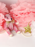 Pink teddy bear and paper decor, pom-pom. Pearls and decorative star Royalty Free Stock Photo