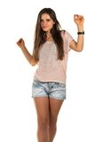 Pink tee. Pretty Romanian brunette in a pink tee shirt and denim shorts stock photography