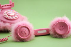 Pink telephone receiver with copy space Stock Photography