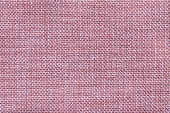 Pink textile background closeup. Structure of the fabric macro Stock Photos