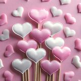 Pink textile hearts on wooden sticks closeup royalty free stock image