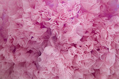 Pink textile ruffles background Stock Photography