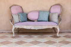 Pink textile vintage sofa. stock image