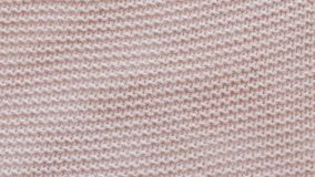 Pink texture of the knitted fabric. Pink texture of the knitted fabric stock video footage