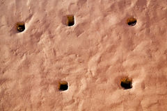 Pink in texture wall hole Stock Photos