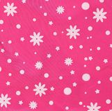 Pink texture with white snowflakes. Royalty Free Stock Photography
