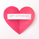 Pink textured folded heart with paper sticker Stock Photos