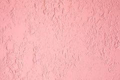 Pink textured plastered wall. Fresh otvetka in commercial premises, designer renovation in the house.  royalty free stock photography