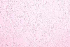 Pink textured plastered wall. Fresh otvetka in commercial premises, designer renovation in the house.  royalty free stock photo