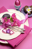 Pink theme Happy Easter dinner table setting - vertical. Decorative Happy Easter dinner table setting with boiled and chocolate Easter eggs Stock Image