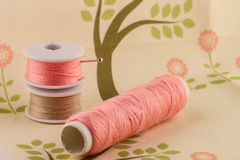 Pink thread on fabric Stock Images