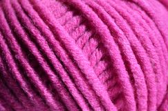 Pink thread rope texture. Close up of a bright pink yarn ball, merino wool Royalty Free Stock Photography