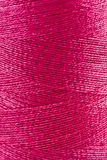 Pink thread in spool Royalty Free Stock Photo
