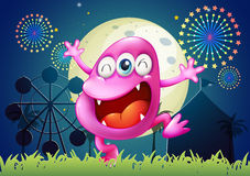 A pink three-eyed monster at the carnival Royalty Free Stock Photography