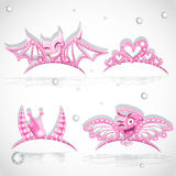 Pink tiaras set with hearts for carnival costume Royalty Free Stock Images