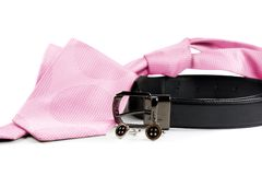 Pink tie with belt and cuff links. On white background Royalty Free Stock Image