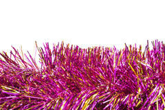 Pink tinsel. Garlands of pink and gold tinsel over white as a background Stock Photo