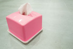 Pink tissue box On a green table. Pink tissue box On a green table in restaurant Royalty Free Stock Photo