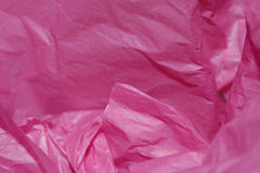 Pink Tissue Paper. Crumpled pink tissue paper for a background or gift wrap for wife, mother, girlfriend, daughter, or sister Stock Photo