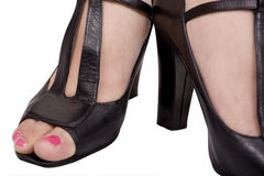 Pink Toes. And black high heel shoes Stock Image