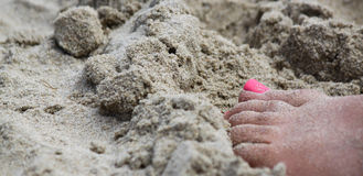 Pink toes at beach. Pink toes in sand at beach, summer day Royalty Free Stock Images
