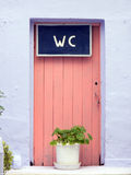 Pink toilet door Royalty Free Stock Image