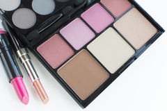 Pink tone makeup palette and lipsticks Stock Photos