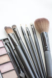 Pink tone makeup palette and makeup brushes Royalty Free Stock Photo
