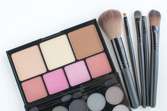 Pink tone makeup palette and makeup bushes Royalty Free Stock Photography