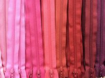 Pink tone zip background. Sewing zip colorful Stock Image