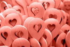 Pink toned wooden cooking spoons with heart shape royalty free stock image