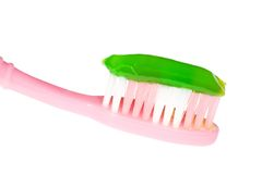 Pink tooth brush with green gel Stock Image