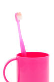 Pink toothbrush and cup Royalty Free Stock Photo