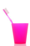 Pink Toothbrush in Cup Stock Photography