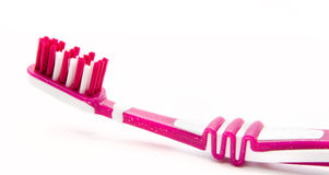 Pink toothbrush  on white Stock Photo
