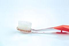 Pink toothbrush with white bristle Stock Photos